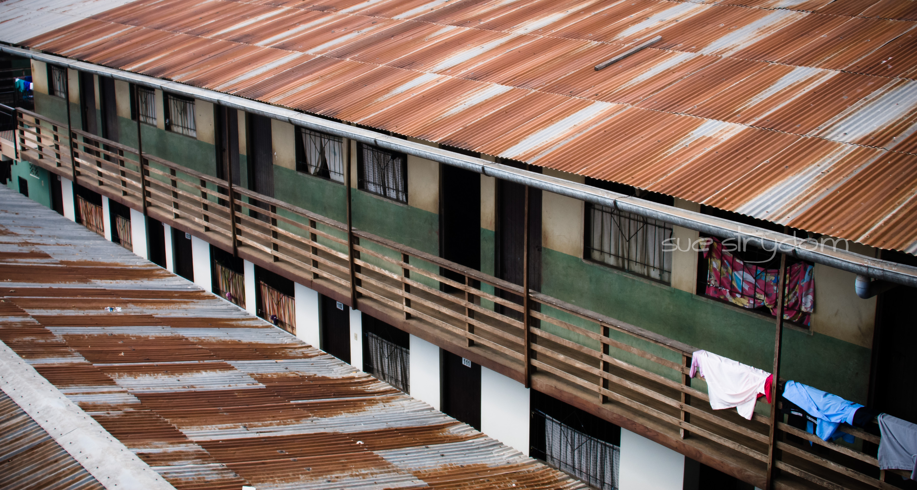 A view from above of one of the buildings where families stay. Each door and window represents one room that could house any number of family members.