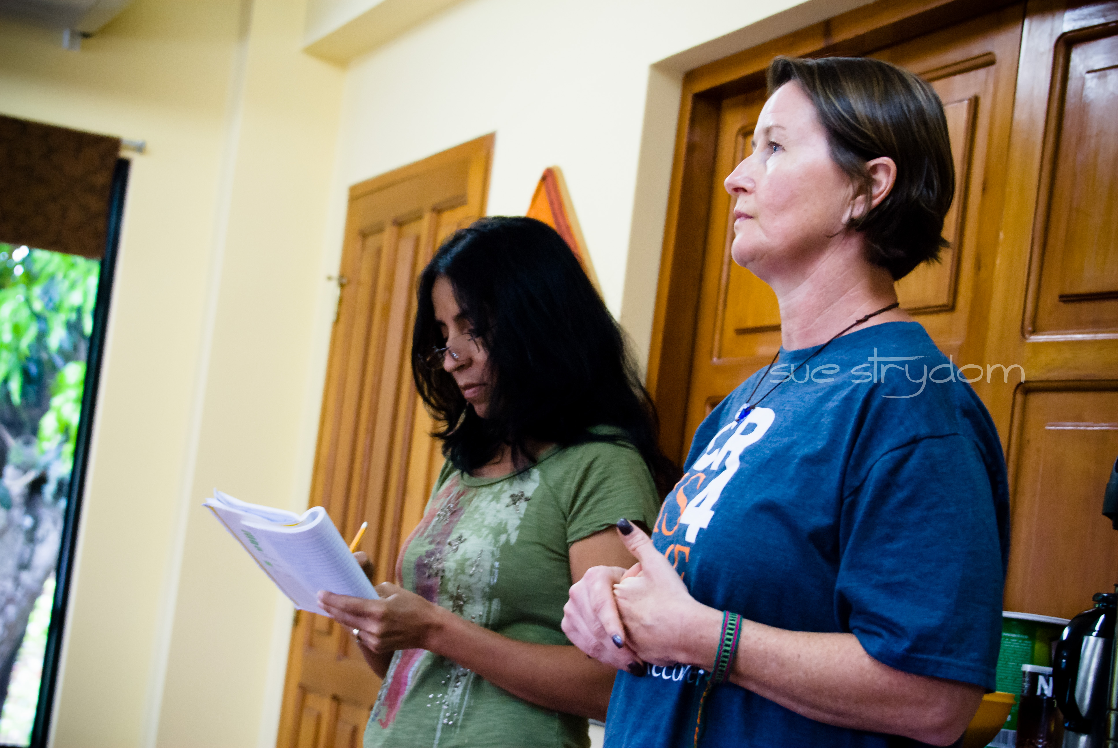 Stacey, telling her story at the CR meeting... with Gioconda's help.