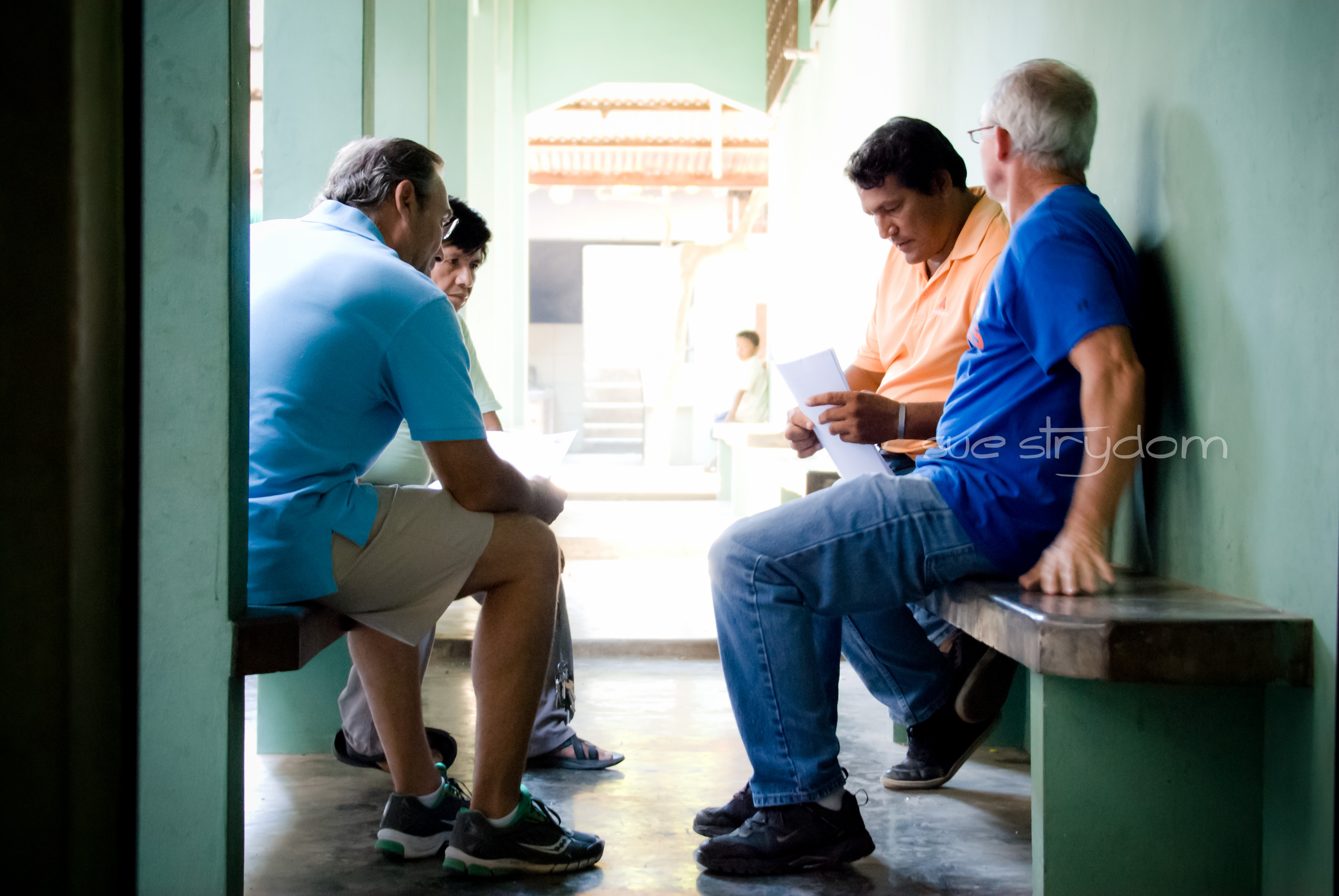 "Glenn, Tom, William and someone from the Center grabbed the opportunity to talk business outside one of the rooms. ""Clean water"" business."