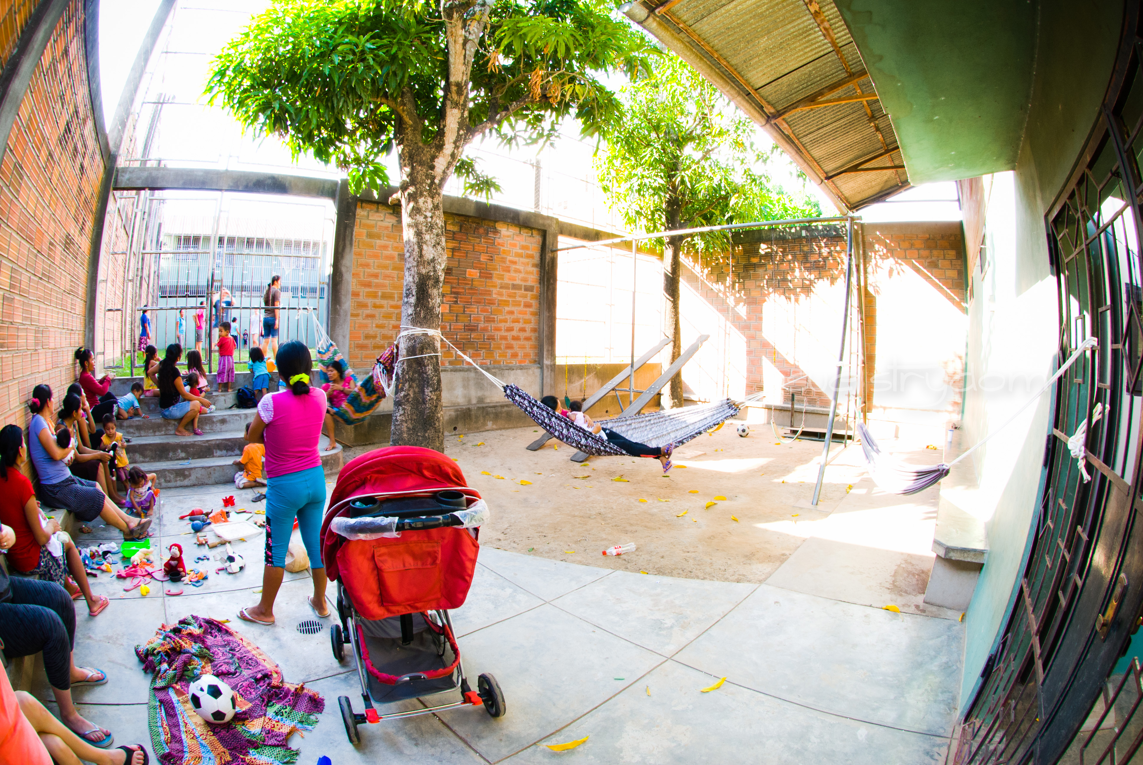 This courtyard is a gathering place for the moms and a playground for the children. The secure gate in the top left of the picture separates the little ones from the hazardous soccer field. The secure gate on the right of the picture keeps the little ones contained and prevents them wandering around the whole Center and into the street.