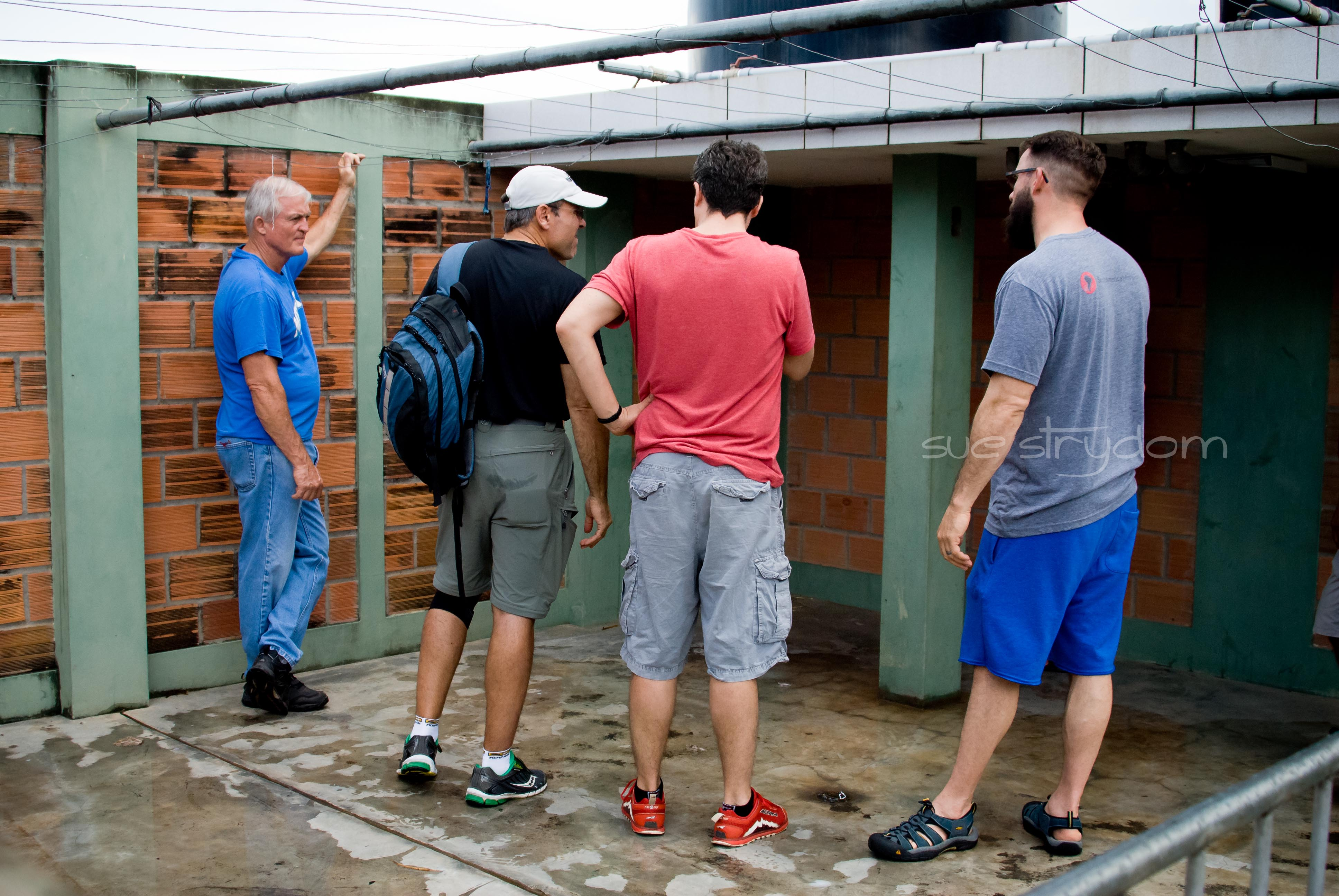 The boys transitioned up to the roof to check out the location of where they'll be installing the clean water system.
