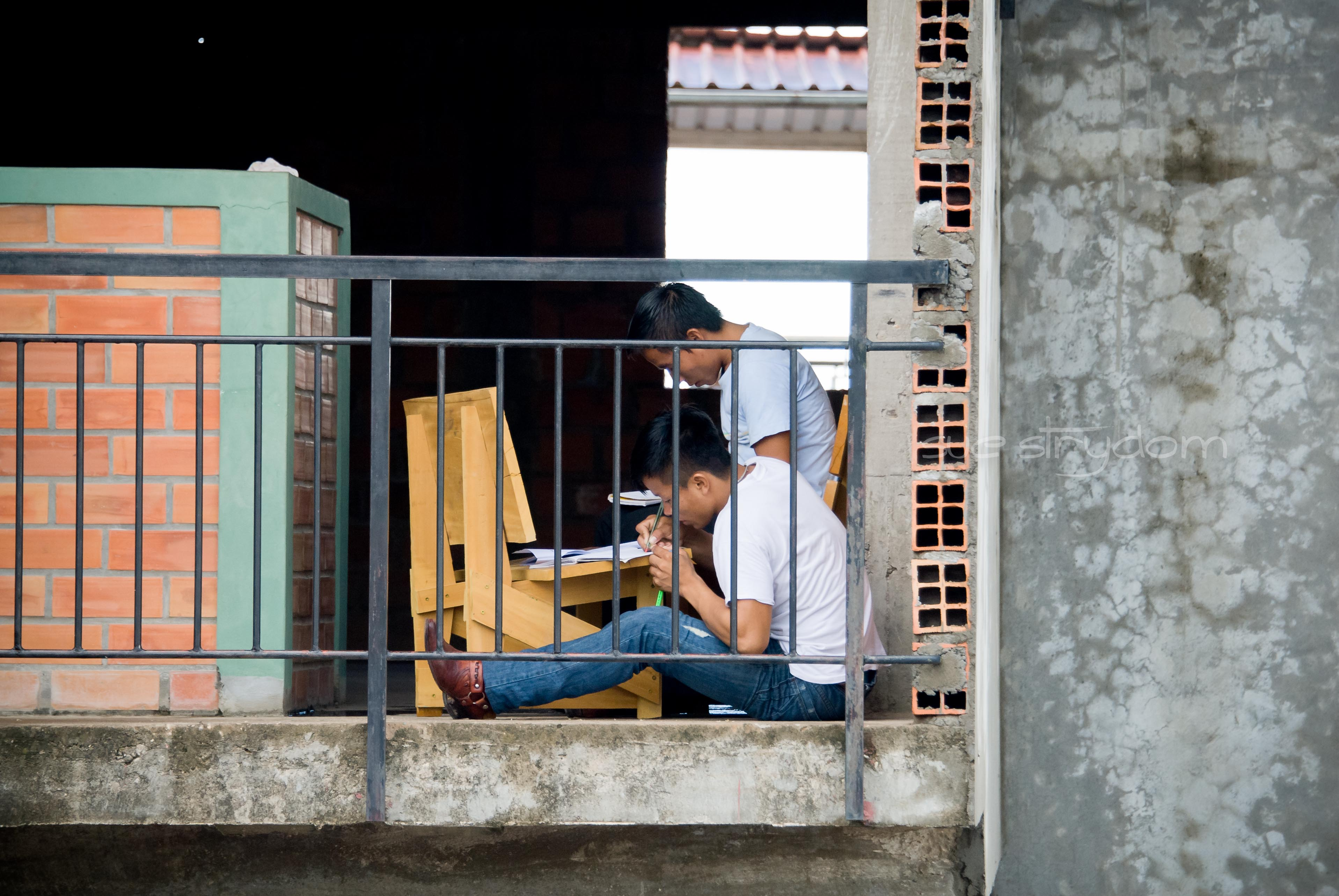A couple of the Bible Institute students. They found a corner with natural daylight to work in and no kids to distract them. That's quite the achievement!! See what they're using as a desk? That's one of the benches our construction team built during our previous trip. Nice to see it's still holding up after 4 months of use!!